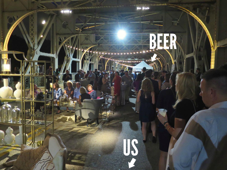 eastfallslocal-line-for-beer-living-room-on-bridge-again-txt